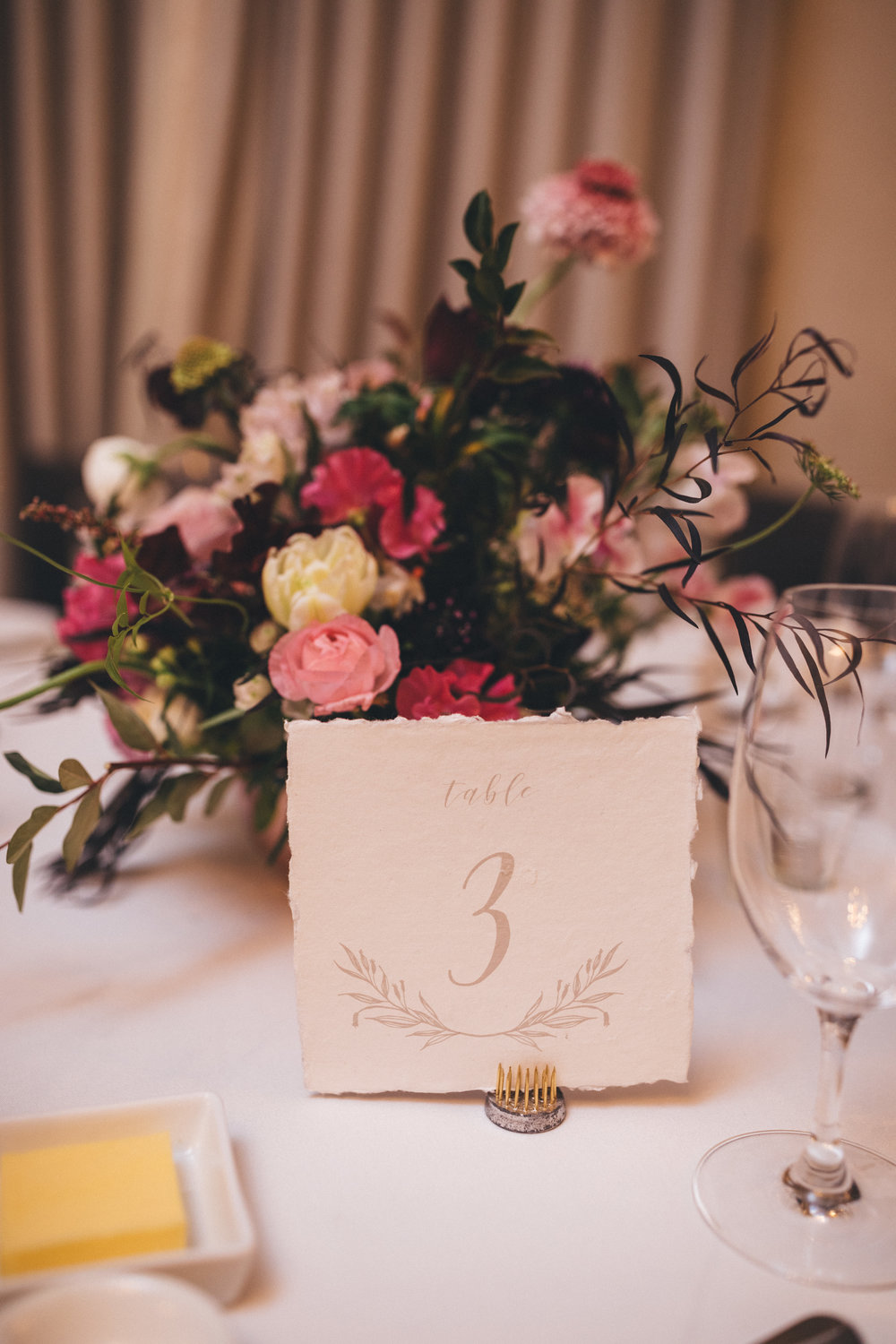 Table numbers - Not every reception venue provides table numbers, or you may not fancy those provided. We can ensure we design table numbers that match your table setting to further add cohesiveness to the overall wedding aesthetic.