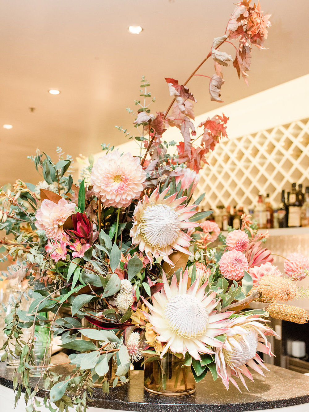 Welcome / bar area decor - Depending on whether the bar area is near your venue's entrance, this can be a two in one! Welcome your guests with a statement display of blooms to up the fancy.