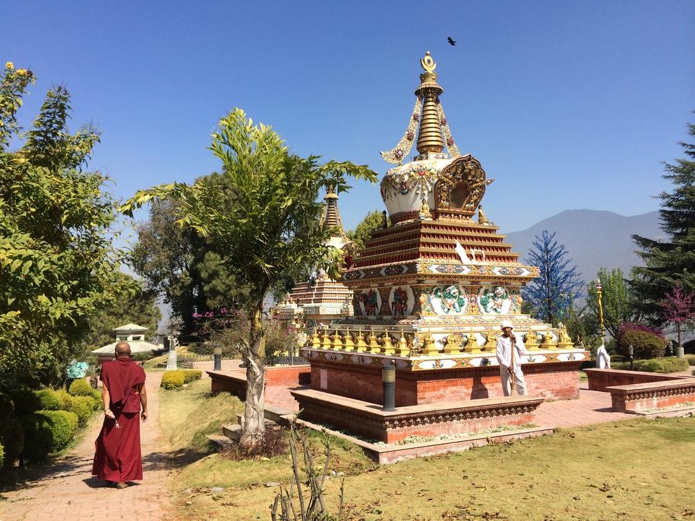 Buddhist Monk next to a stupa