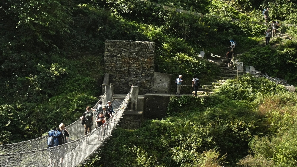 Crossing a bridge during the Poon Hill trek