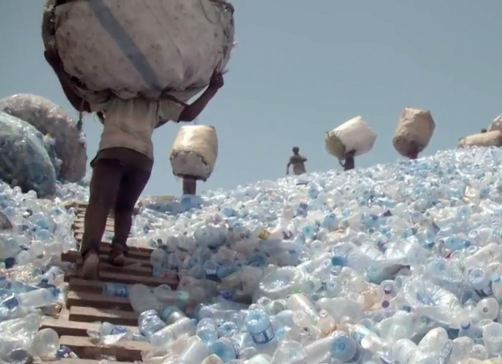 Charles Dickens  -  To attack a mountain of used plastic bottles
