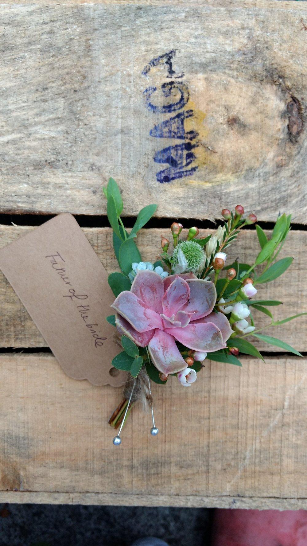 pink succulent buttonhole