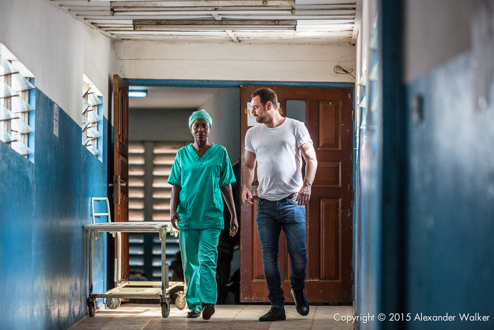 Danny Dyer with Nurse Lucia during a visit to the OLA During Childrens Hospital, GAVI Alliance.  Comic Relief has funded GAVI since 2012 and awared funds in 2014 to purchace and deliver three lifesaving Vaccines to hundres of thousands of children in a selected number of African countries.  Immunisation is one of the most effective ways of preventing children from dying from diseses.  In africa alone, 600,000 children each year could be saved in vacccine programmes  were fully implemened.  Most countries have now introduced immunisation programmes in their national health plans, but almost a quater of african children are stil not being vaccinated adequately.