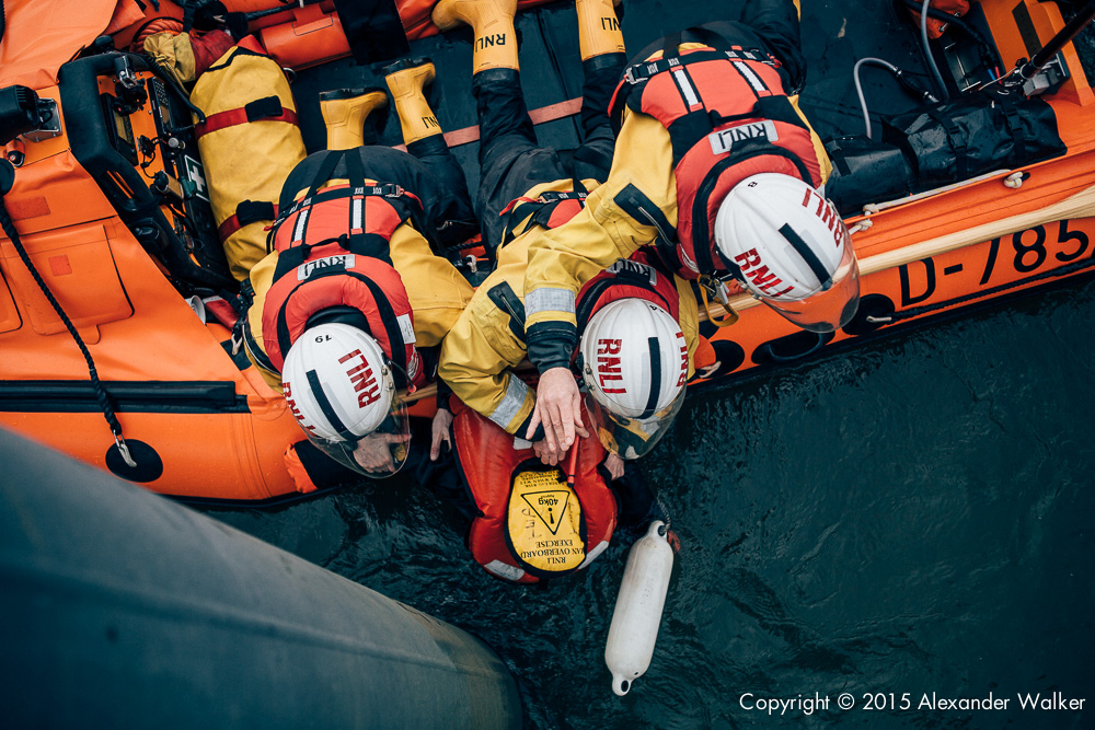 Matt Allchurch, Mark Gibson and Jon Chapman, Volunteer Crew at Teddington Lifeboat Station RNLI onboard the station's Class D Lifeboat on a training exercise practiing man overboard drills