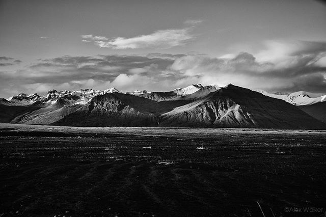 Evening sun glistening on the hills towards Skaftafell/Vatnajökull National Park - Iceland • • • • • #iceland #explore #mountains #mystopover #outdoors #weather #monoart #monochrome #photojournalist #lifestyle #blacknwhite #clarity #life #adventure #skaftafell #drama #canon #canon5dmk3 #canon35mm #hiking #cinematic #landscape #landscapelovers #travel #Bnw_life #Bnw_captures #Instablackandwhite #fineart_photobw #bnw_life #bnw_society