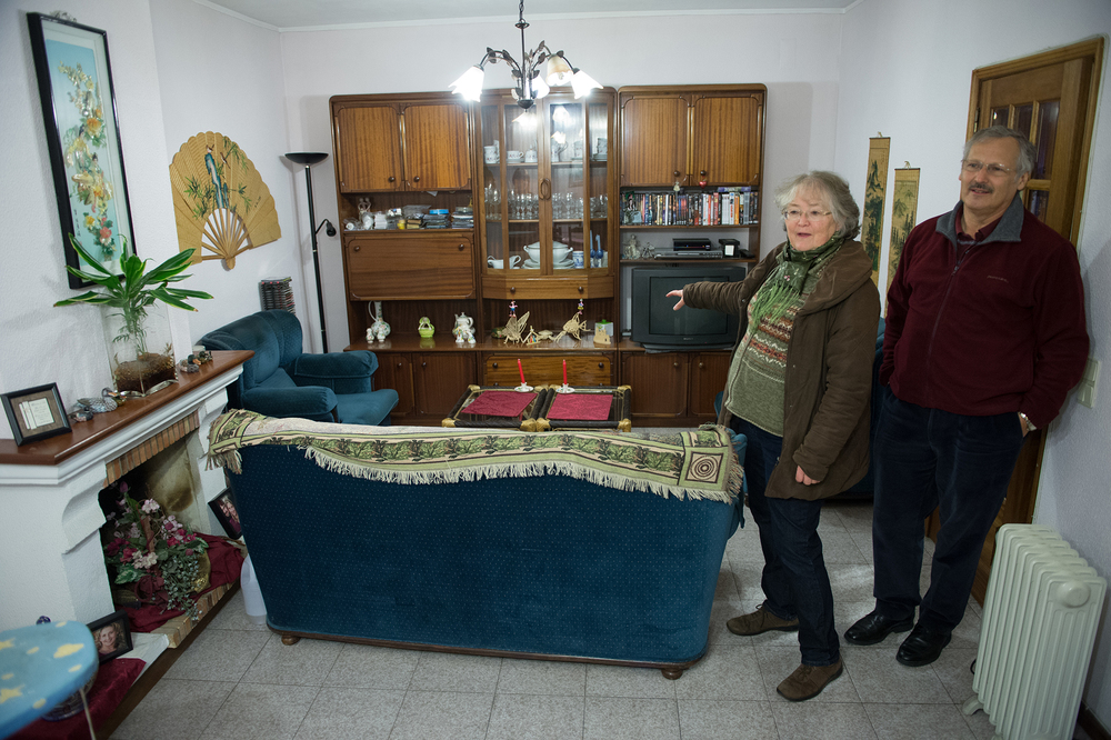Clark and Yvonne Malone stand in their small living room in Ermesinde, Portugal, showing how they would set up the room for service every Sunday. The small space filled up with around 30 people for the worship services.