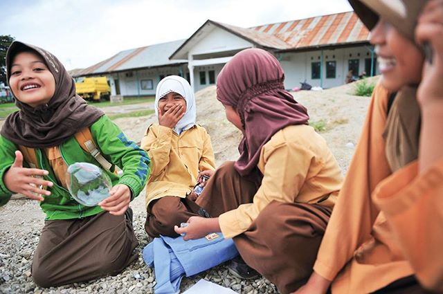 After finishing their classes, these young girls sit on a pile of gravel left during the reconstruction project on the Al-Aqso Merauke Grand Mosque in Merauke, Papua, Indonesia. ⠀ -⠀ In many countries, the Muslim gender gap in education remains large . . . but a study by @pewresearch shows that in recent generations Muslim women have made greater educational gains than Muslim men.⠀ -⠀ #photojournalist #photodoucumentary #reportagespotlight #ngostorytelling #ngo #ngophotographers #ngophotography #nonprofitorganization #nonprofitwork #thegreatcommission #greatcommission #communityservice #missions #seekhimfirst #loveothers #helpthoseinneed #loveothers #liveauthentic #alifealive #folkgood #forgeyourownpath #gobe #socality #finditliveit #impact #advocacy #aspire #connected #compassion #givehope