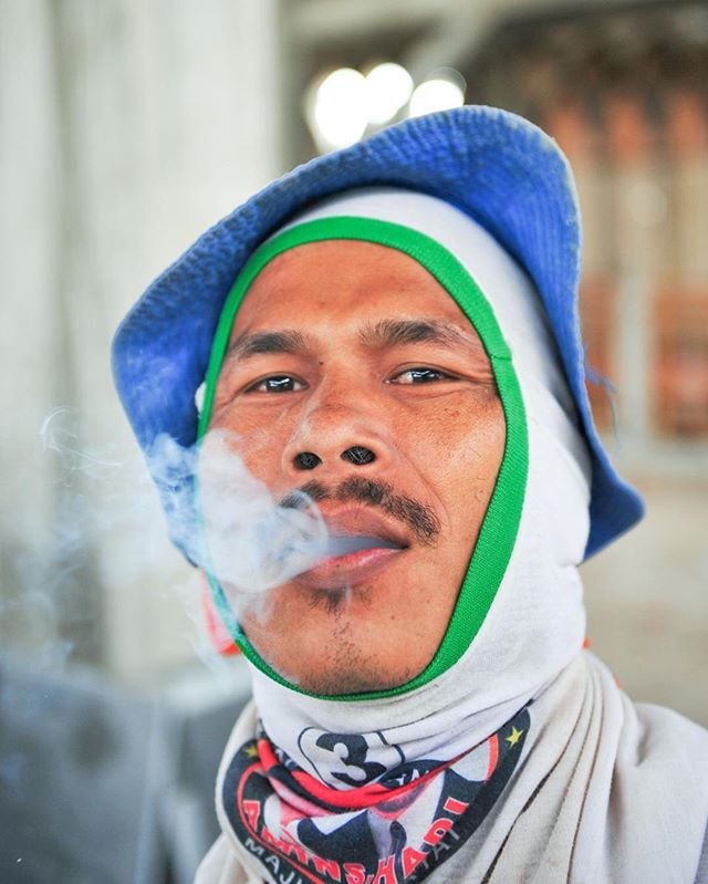 Taking a break from working on the newly constructed mosque in Merauke, Papua, Indonesia, this Indonesian cement worker enjoys his cigarette. Initially built in 1980, the mosque under went a major renovation and expansion project in 2011. Now the grand mosque boasts multiple stories, marble floors and walls and over 6,000 square meters.⠀ -⠀ #portraitsociety #portrait_planet #majestic_people #people_infinity_ #photo_storee_people #photojournalist⠀ #photodoucumentary #reportagespotlight #ngostorytelling #ngo #ngophotographers #ngophotography #nonprofitorganization #nonprofitwork #portrait_collective #portraitsfromtheworld #thegreatcommission #greatcommission #communityservice #missions #seekhimfirst #injesusname #outreach #missionstories #journalist #reporter #journalismmatters #liveauthentic #exploreyourworld⠀ ⠀