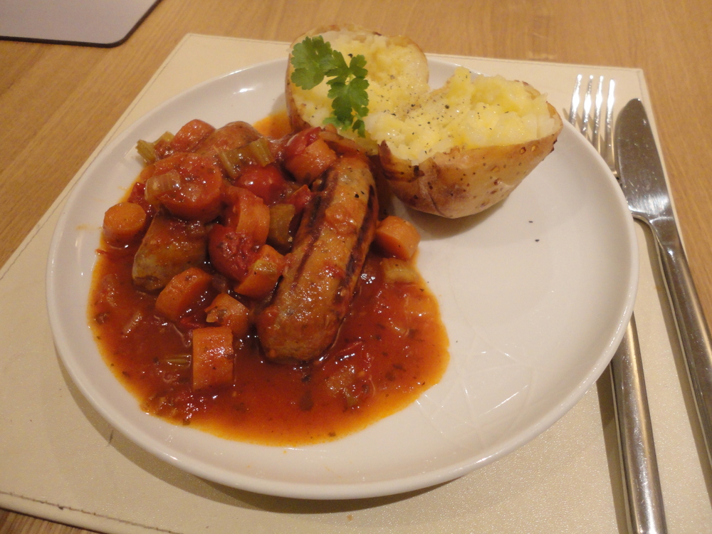 Sausage casserole served with a jacket potato