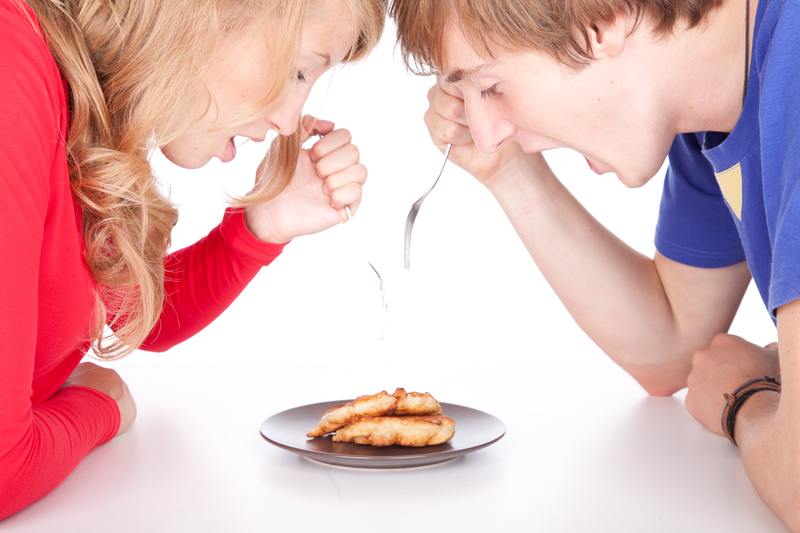Sibling Rivalry - even when it comes to pie eating.