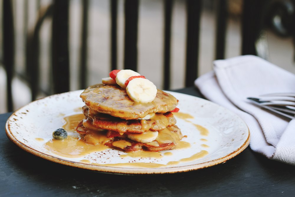 Stack those pancakes high with fruit and sauces!