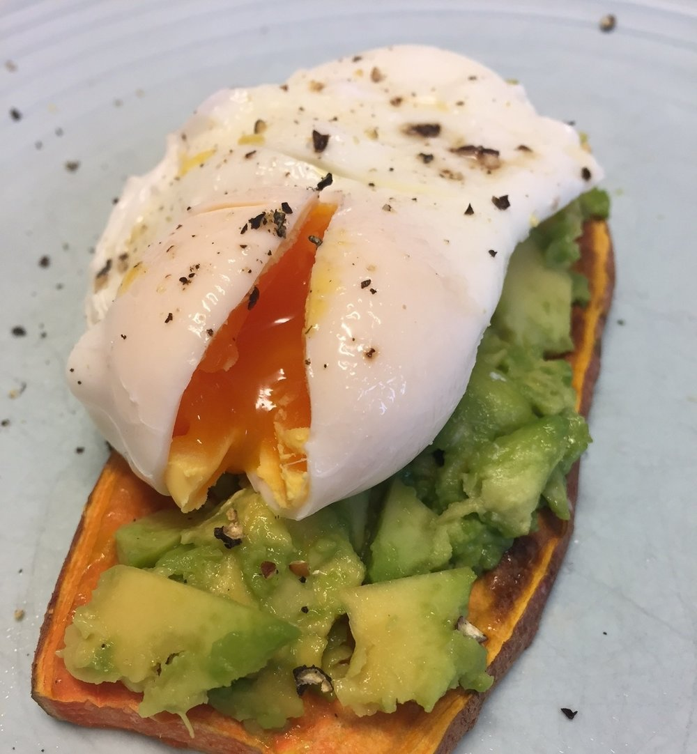 Sweet potato toast topped with crushed avocado and a poached egg!