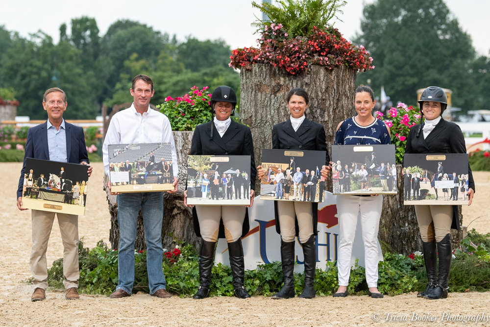 Jen Alfano, third from left, with the past winners of the USHJA International Hunter Derby Championships, from left, John French, Hunt Tosh, Liza Boyd, Kristy Herrera and Tori Colvin.