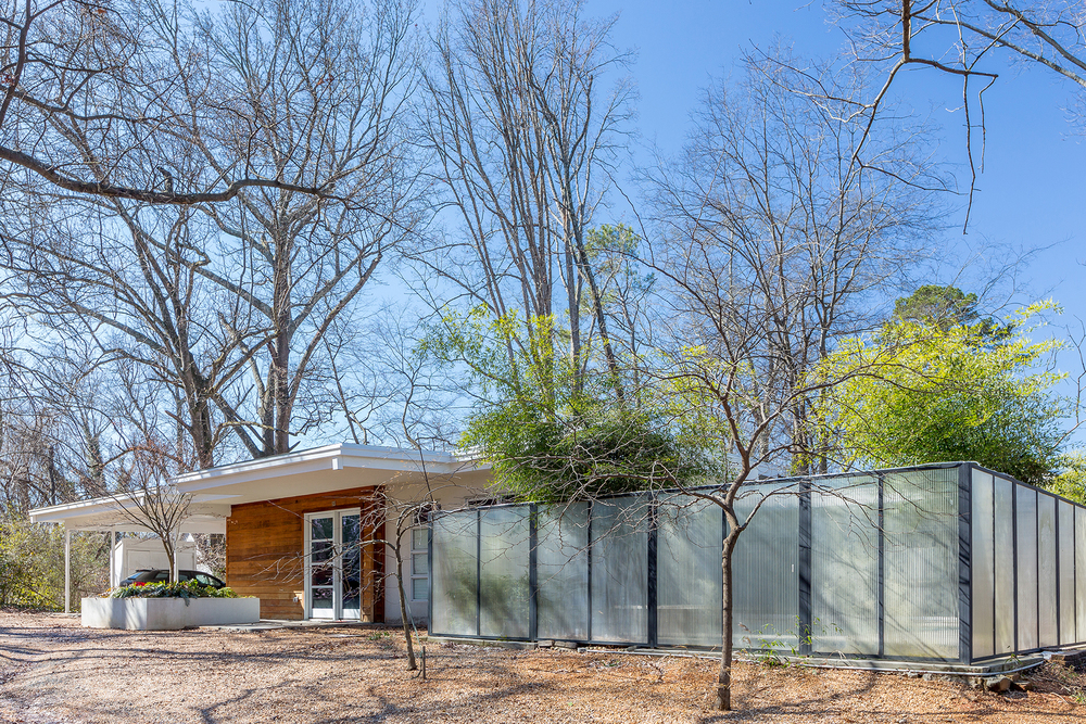 This modern single level residence is located on a wide and wooded in-town lot, the design of the home revolves around the private courtyard and the single lane swimming pool. These amenities are visible and accessible from all of the main rooms via large sliding glass doors. The play of light and water can be heard and seen deep into the house providing a serene yet dynamic retreat from its urban setting. The residence consists of: open living/dining/kitchen, 2 bedrooms, 1 bedroom/studio suite, 3 bathrooms, 2 car carport and a swimming pool~ 1800 sqft.