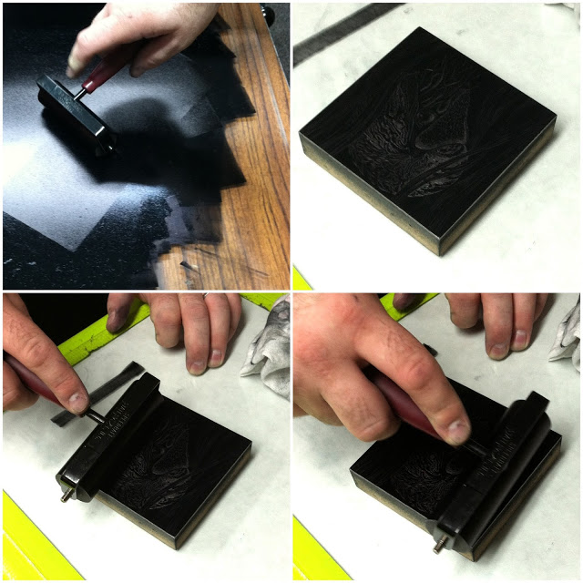 The block being inked with a brayer