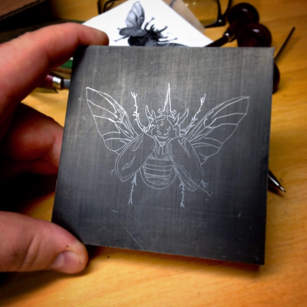 "The drawing of the ""Rhinoceros Beetle"" on a block of Resingrave."