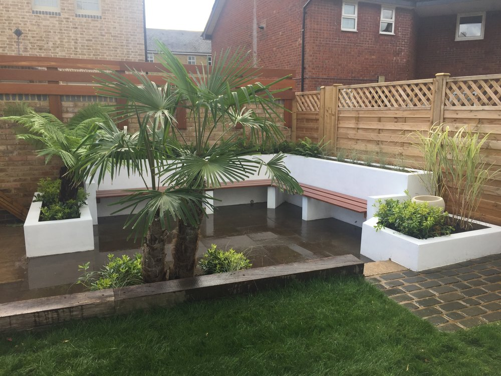 Built in garden seating and lush planting