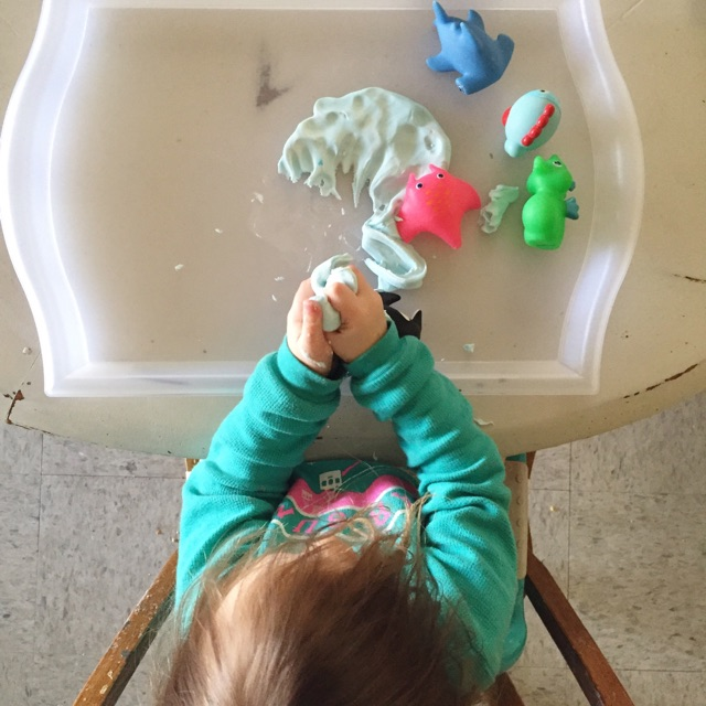 playing with homemade cornstarch play-dough (an ocean) and fish