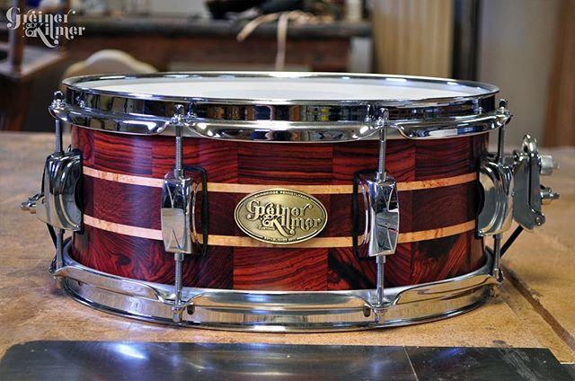 "Beaut of a little instrument. 13"" cocobolo, maple, and bloodwood snare. Poppy little fella who can't wait to meet it's new owner! ⠀ ⠀ Follow the link in our bio to see what GK drums you could still own. On sale this weekend as your last chance at owning a GK drum! #greinerkilmer #customdrums #segmentedsnare"
