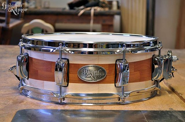 This is a unique design for a segmented snare, the cherry stripe in the middle grows larger as it goes around the center of the drum! For the unique drummer in your life. Follow the link in our bio to see what drums are left for sale this weekend! #greinerkilmer #customdrums #segmentedsnare