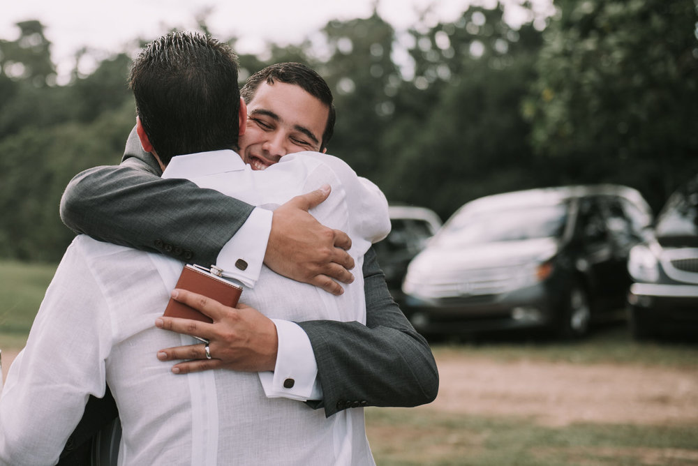 12_Hugging_a_guest_groom.jpg