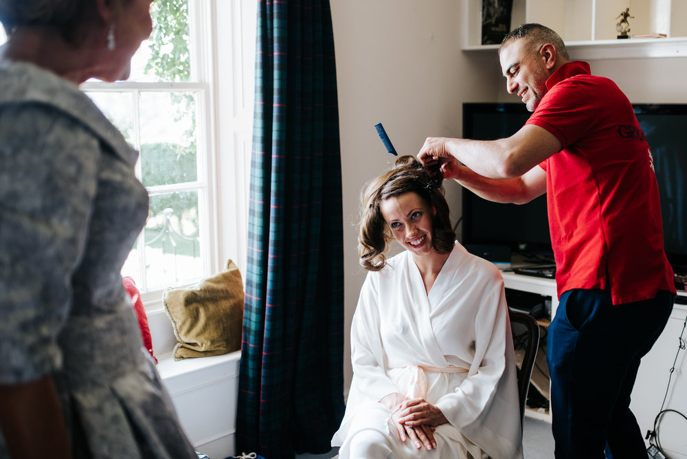 Bride looks at mother while she has hair done