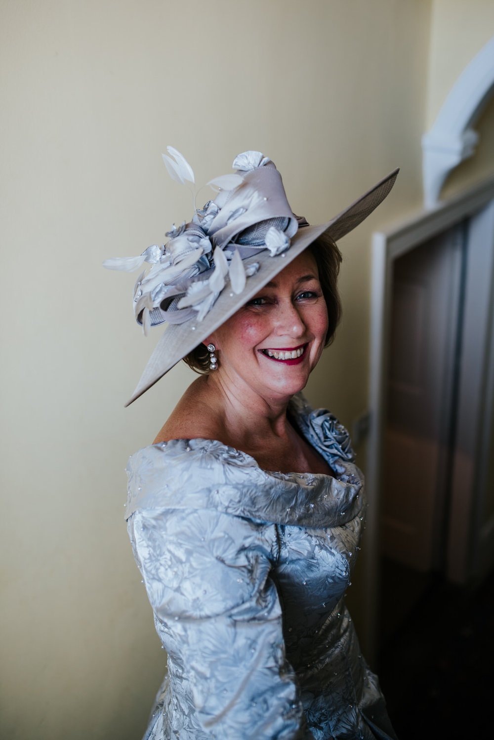 Mother of the bride looks fantastic with regal hat