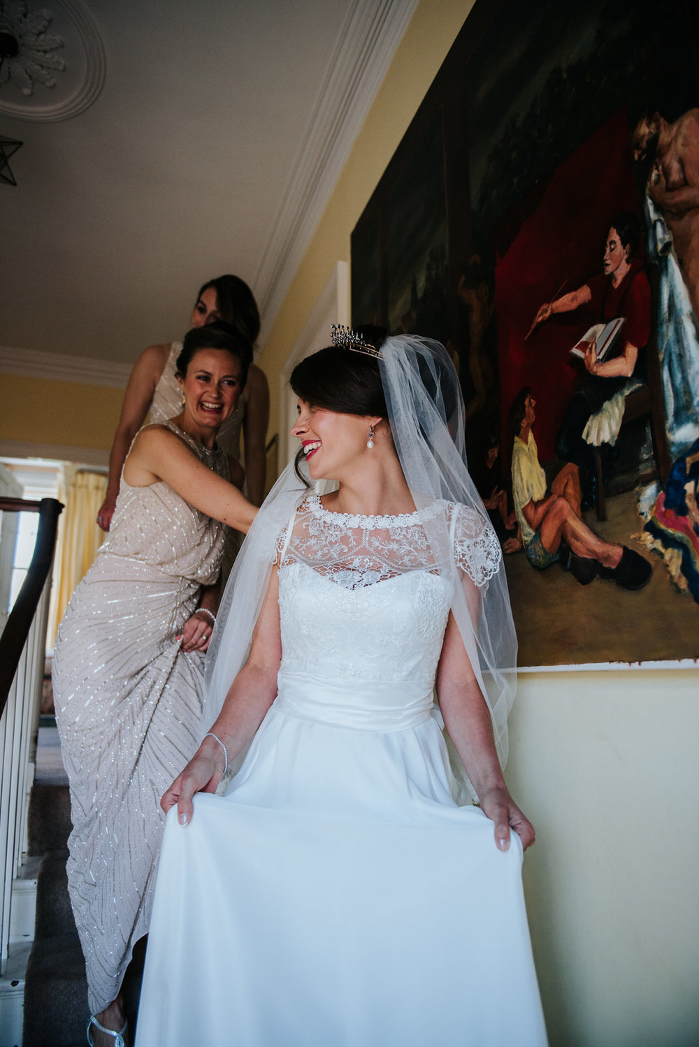 Bride looks in the mirror for the first time since putting dress