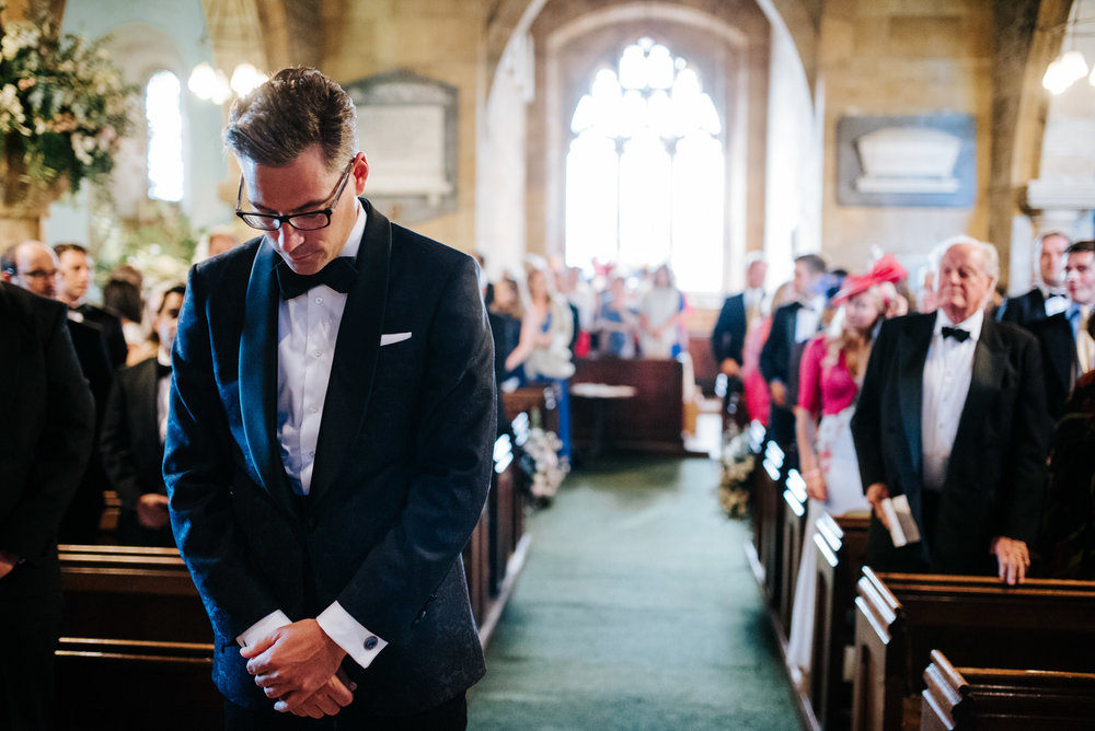 Groom waits at altar in Felixkirk Church