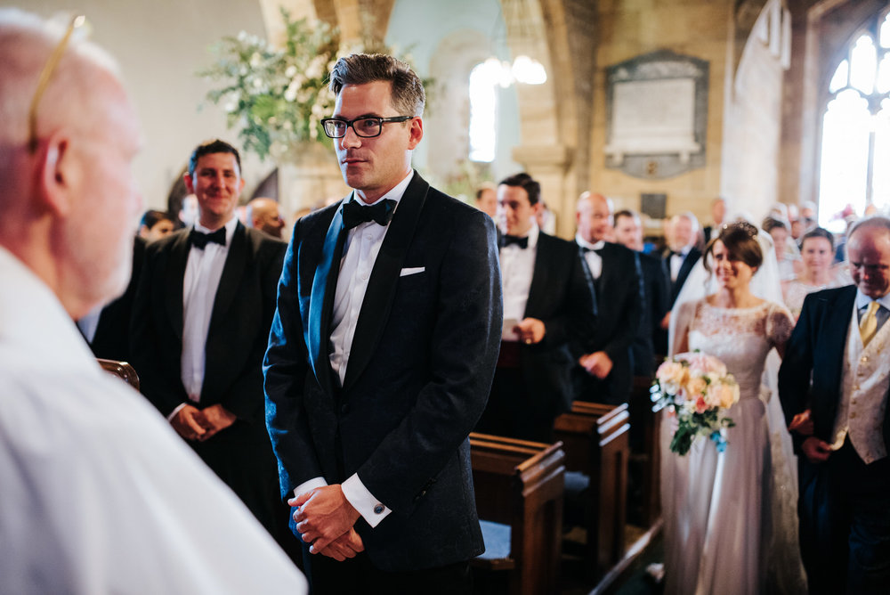 Groom nervously waits at the altar in Yorkshire as Bride inches
