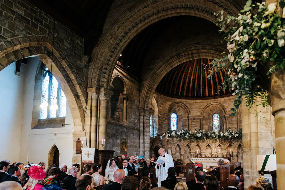 Wide shot of Felixkirk Church interior highlighting the architec