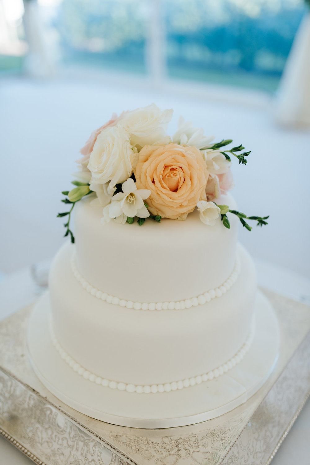 Photo of wedding cake with flowers by Twinkling Twine