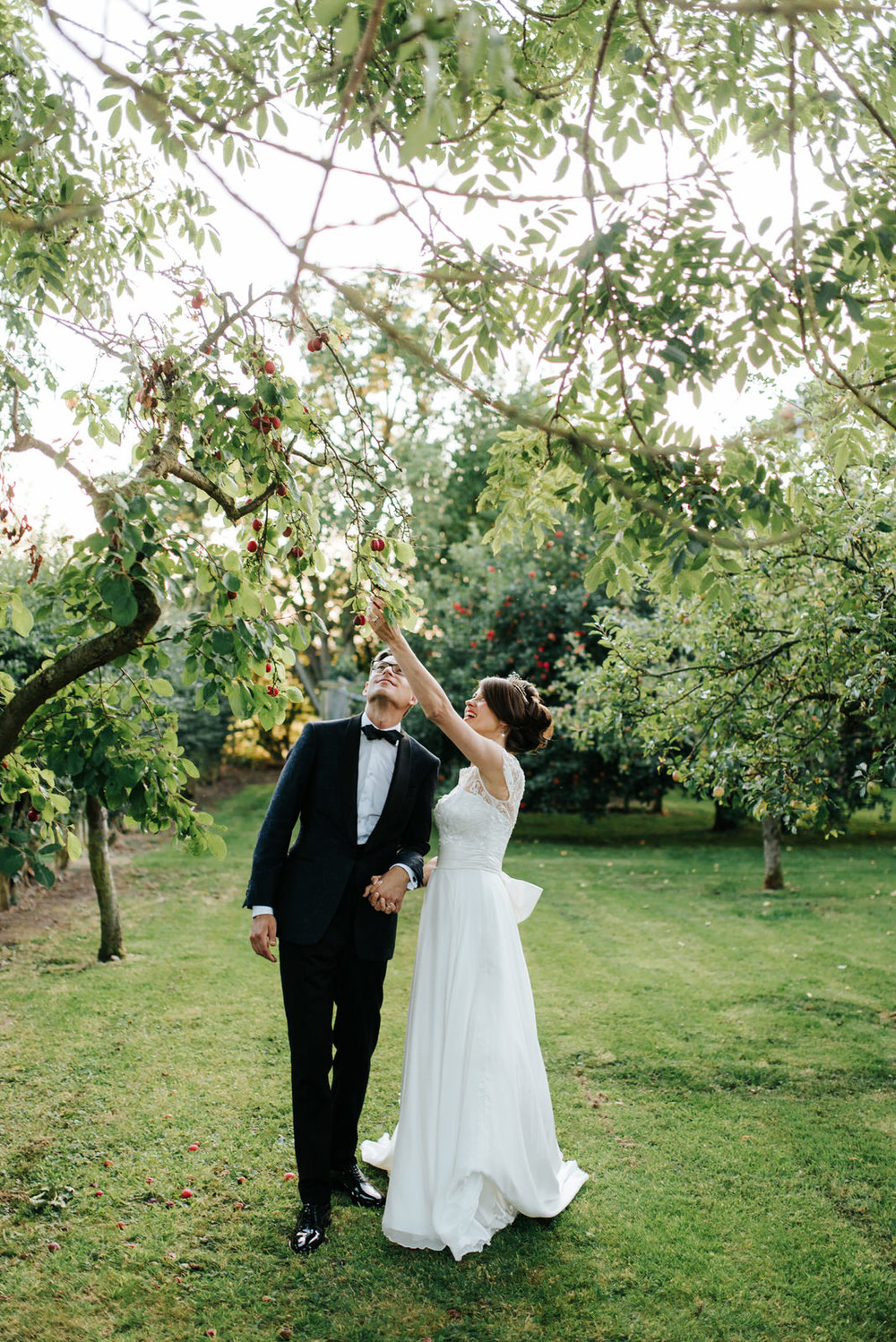 Bride and Groom standing under Plum tree in Yorkshire