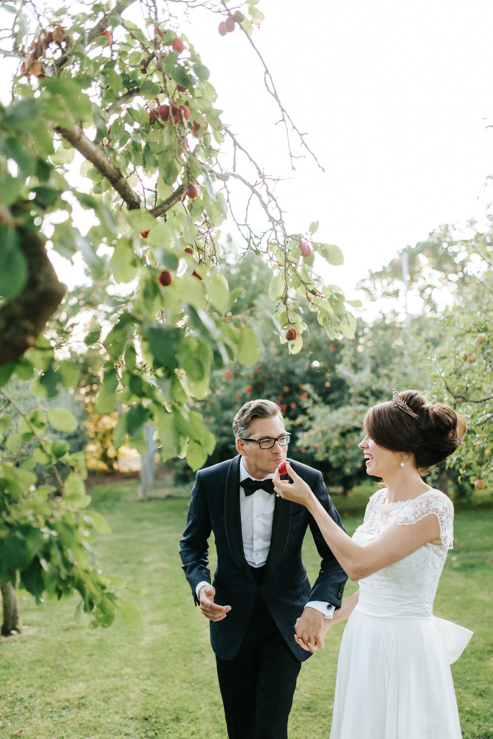 Bride gives plum to Groom so he can take a bite out of it during