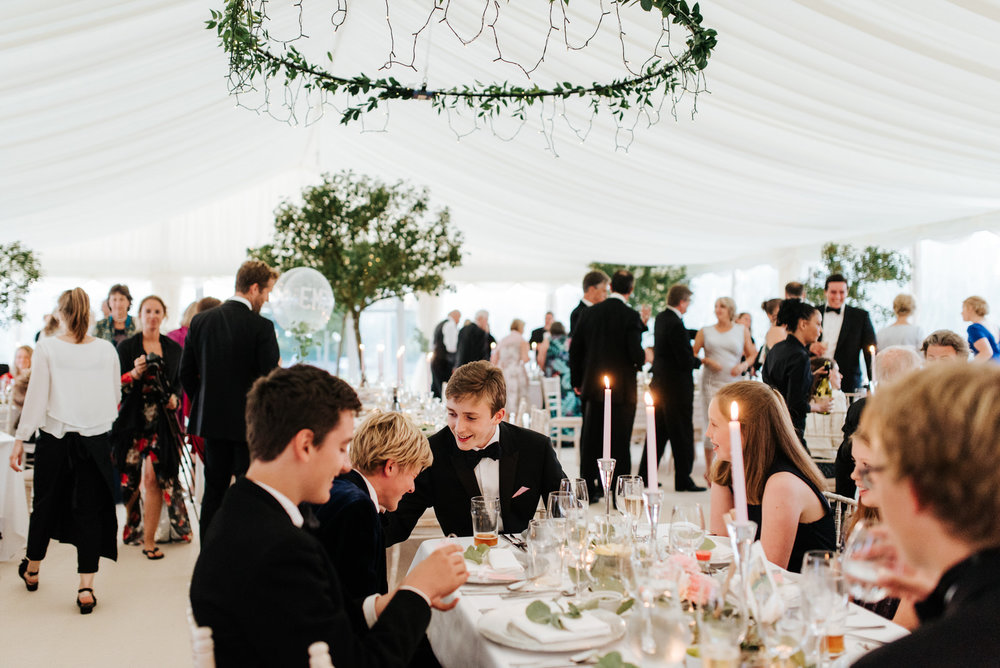 Guests make their way to their tables inside Garden Marquee