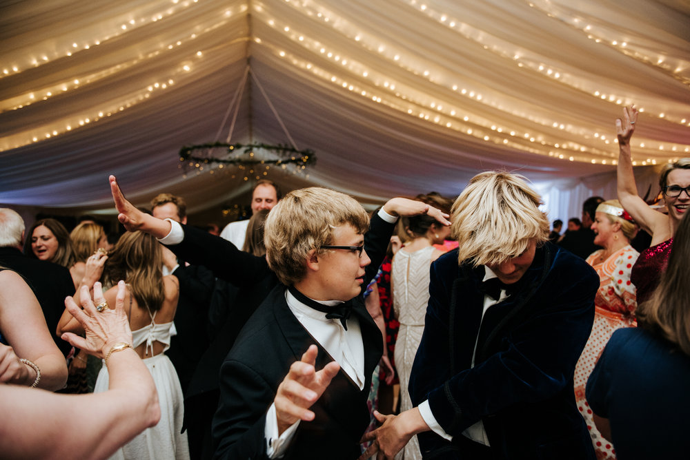 Guests flood the dancefloor under marquee fairylights