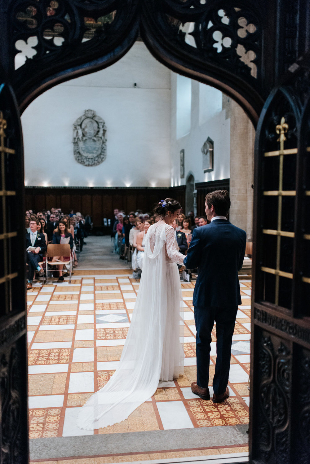 Bride and groom walk out towards guests during wedding ceremony