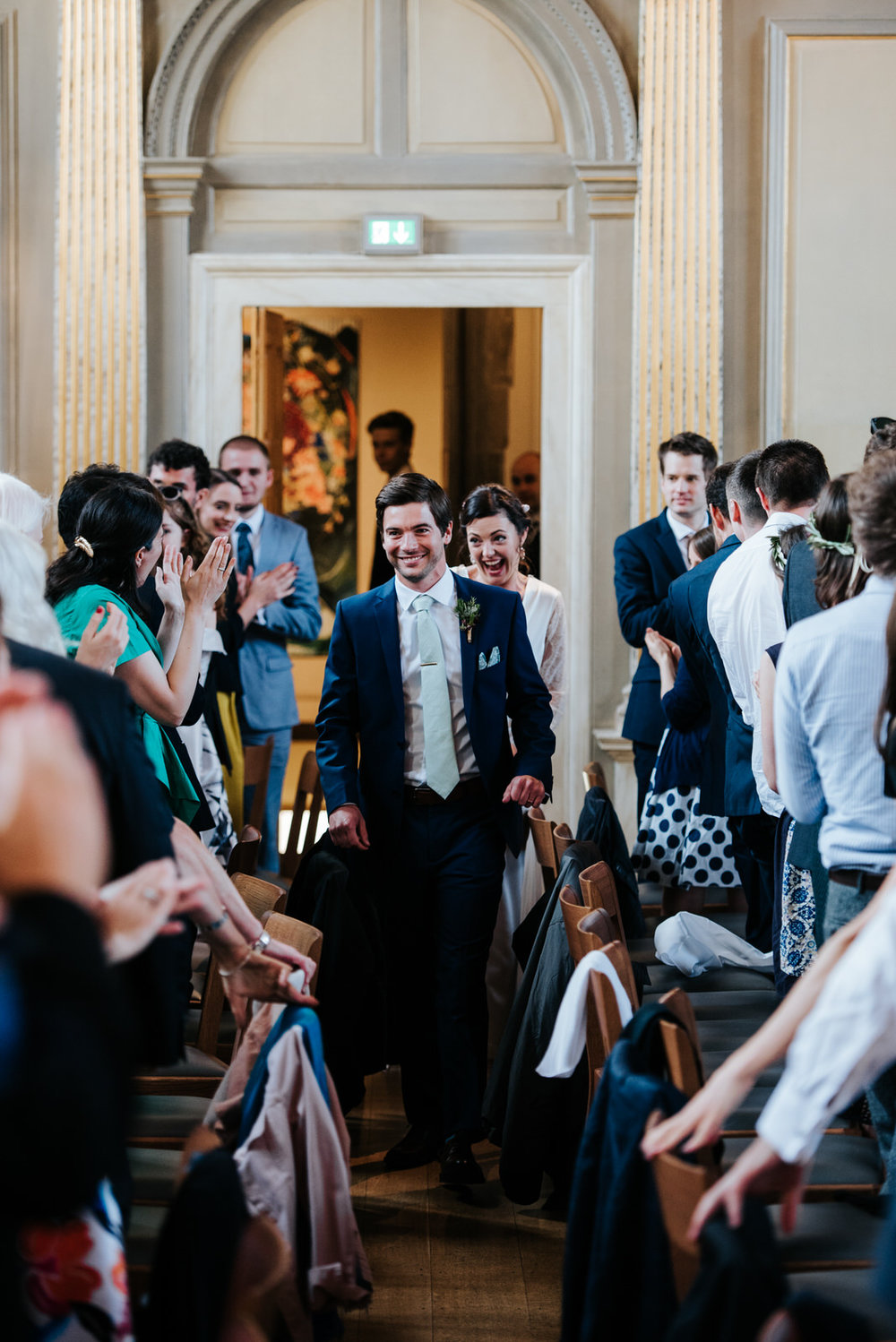 Bride and groom make their grand entrance into Jesus College Din