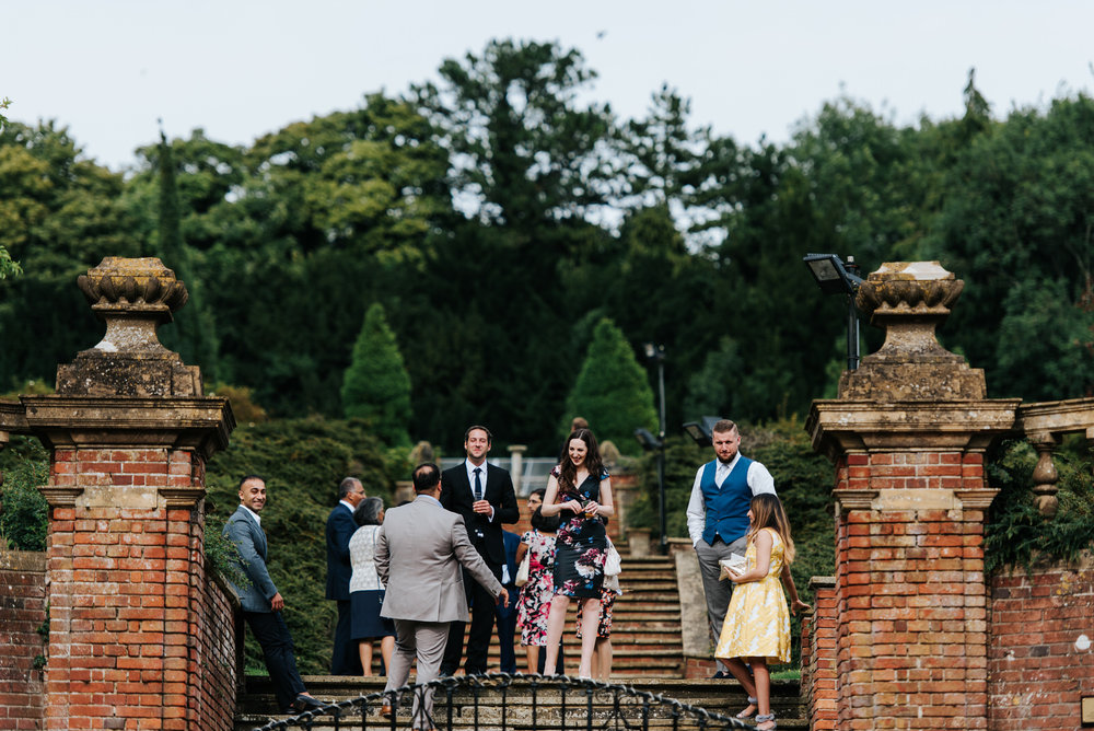 Guests enjoy themselves in Woldingham School gardens during wedd