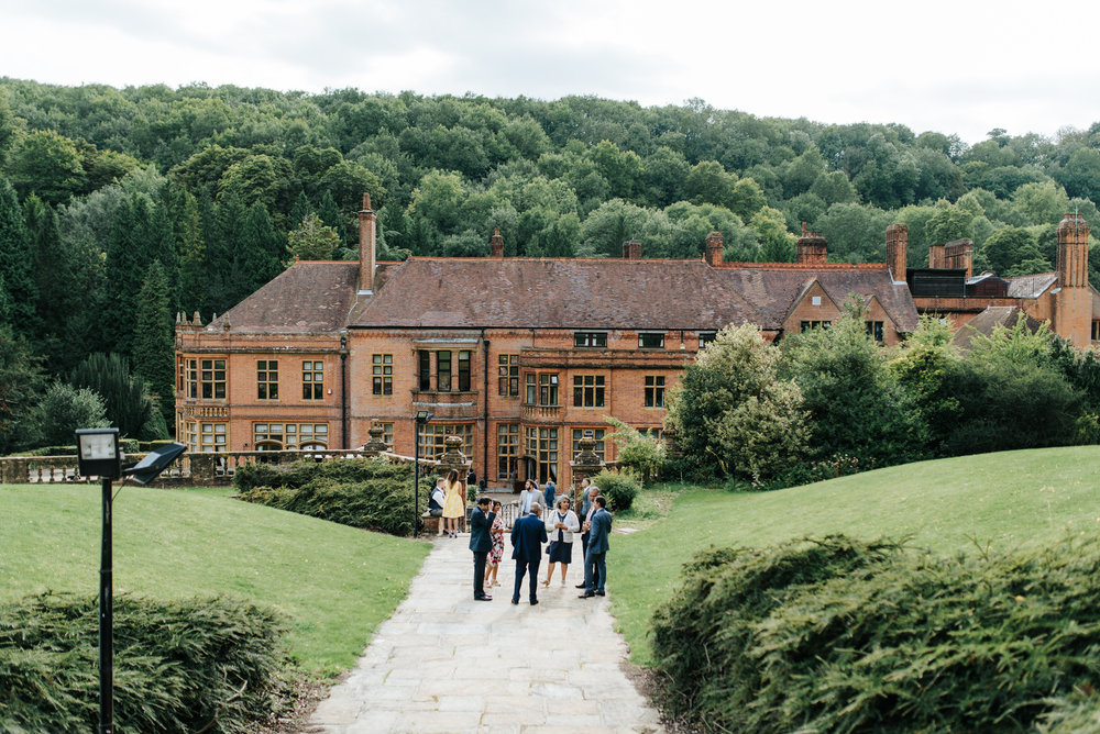 Wide shot of Woldingham School and surrounding greenery as guest