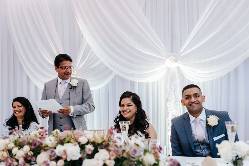 Father of the bride delivers speech during wedding breakfast as