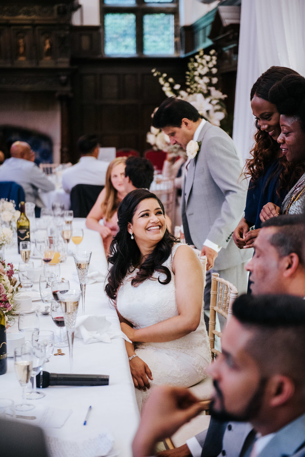 Bride can't stop smiling as she entertains two guests that came