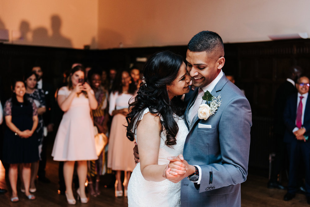Bride and groom share their first dance together in front of the