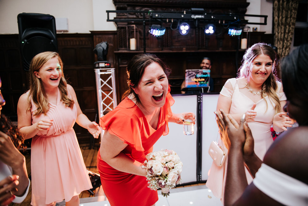 Guest of the wedding catches the bouquet and cannot contain her