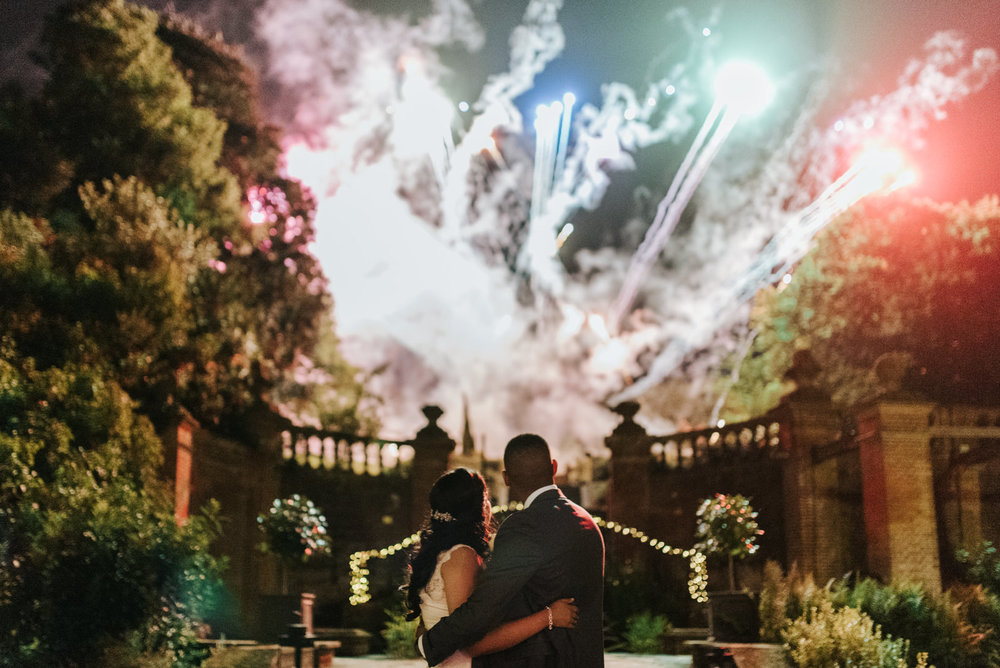 Bride and groom stand and look out into a phenomenal display of