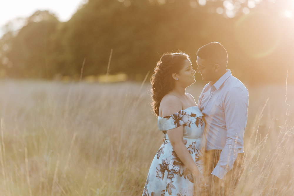 Couple stands under the sun in beautiful photograph taken in Ric
