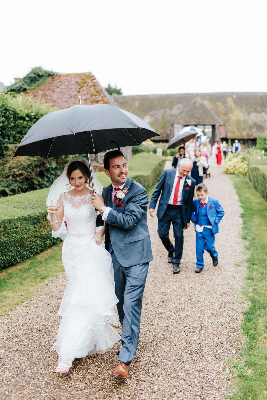 Bride and groom walk towards evening reception venue at Colville