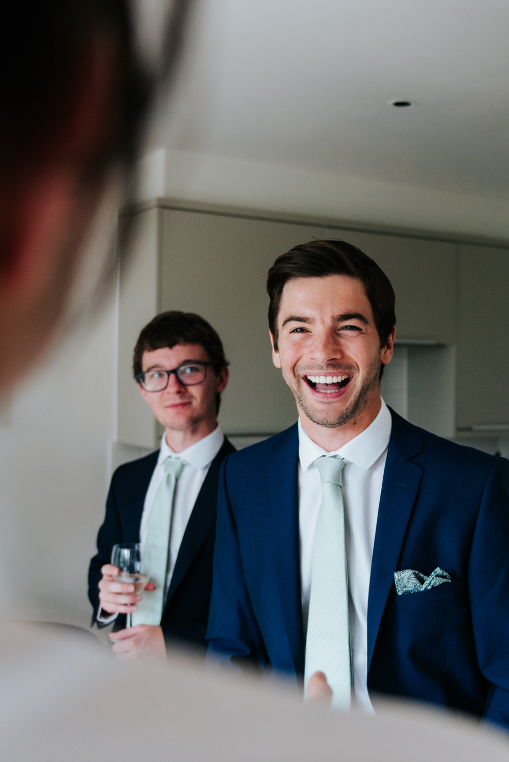Groom incredibly happy that it is his wedding day while talking
