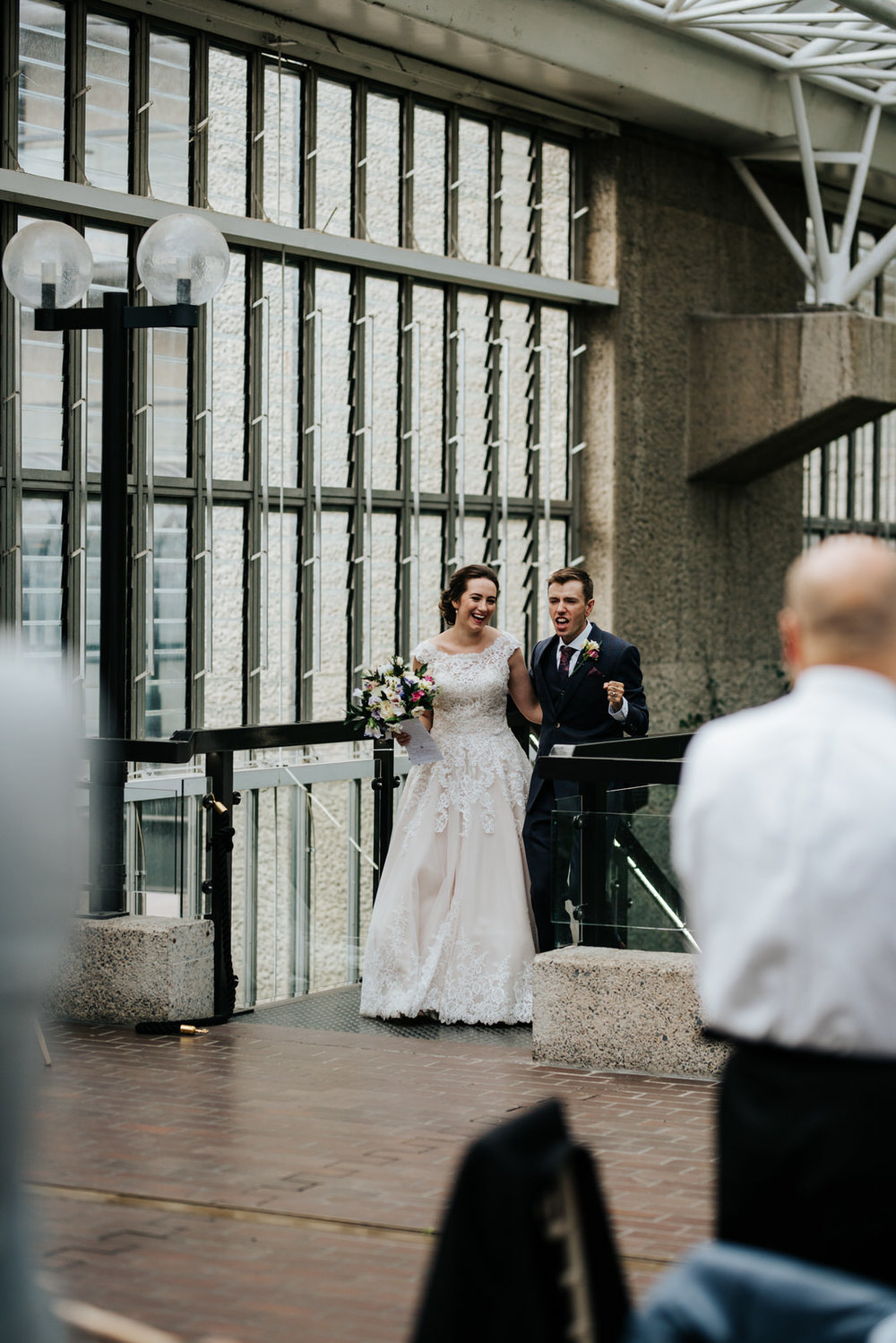 Bride and groom make their entrance into wedding breakfast room