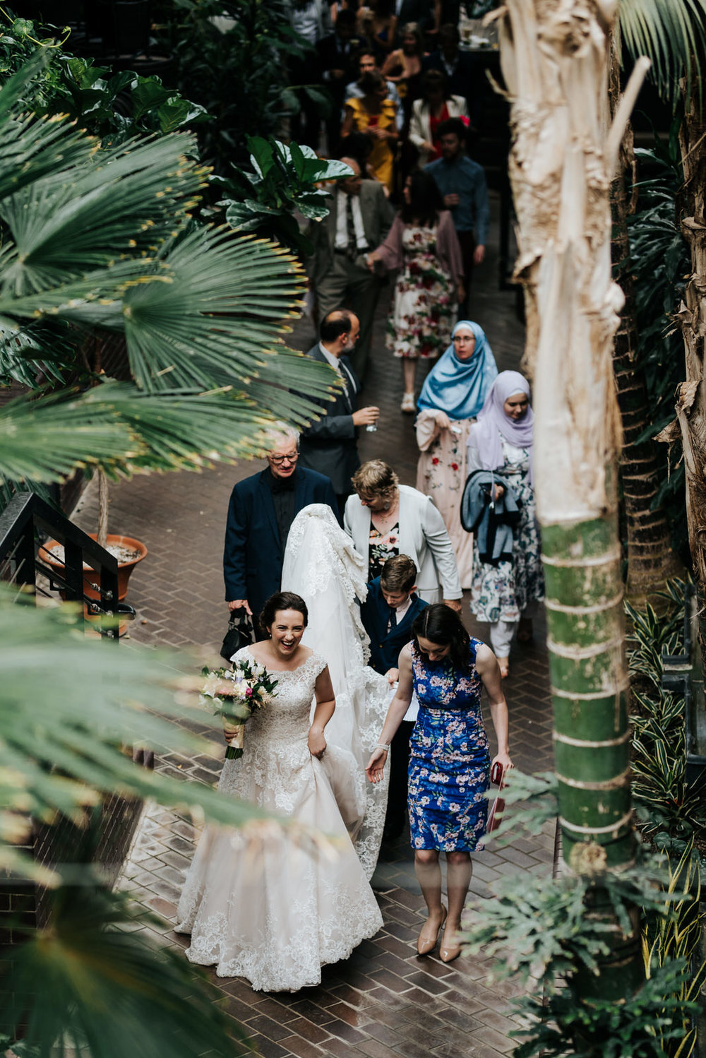 Wide photograph from above of bride leading guests to wedding re
